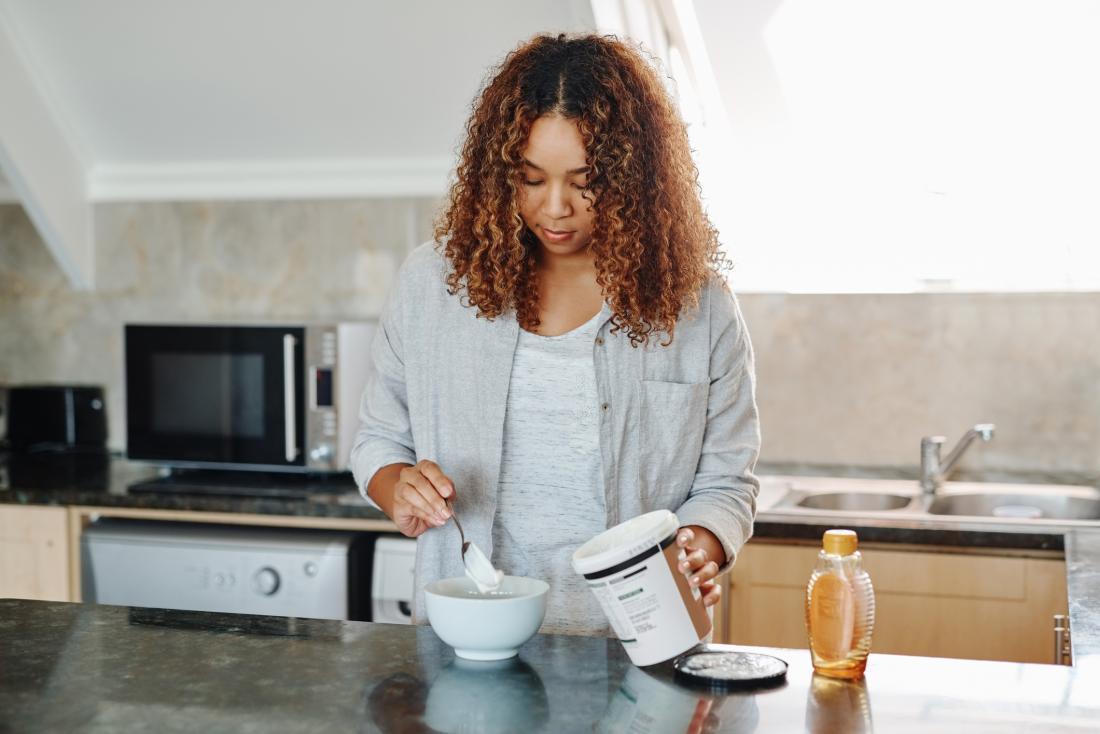 Woman pouring yogurt