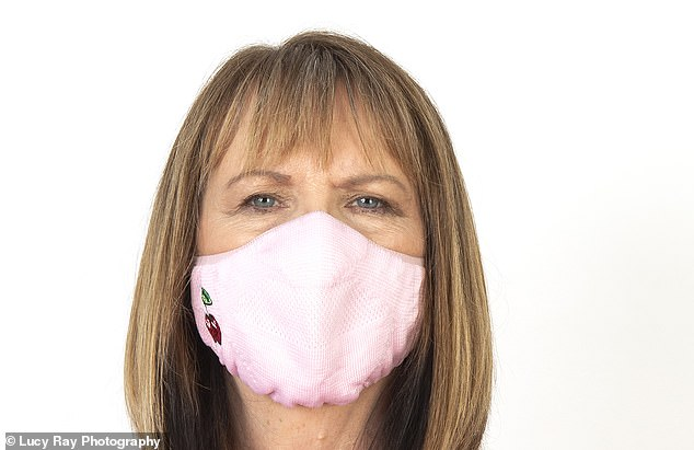 Face coverings may be compulsory in more places now than ever — but how much protection do they really afford to people around you?Professor Val Edwards-Jones is pictured above testing a mask