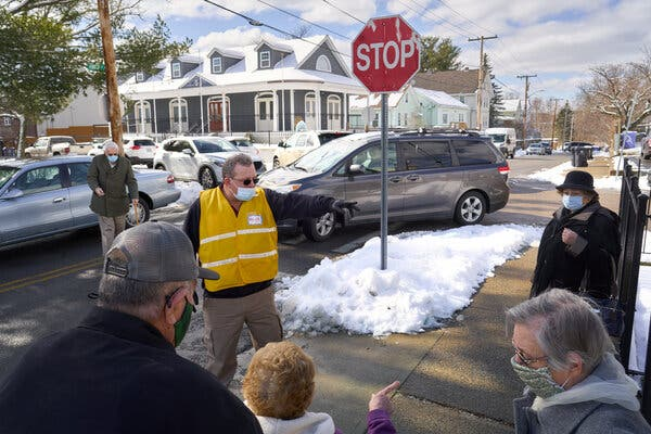 Elderly citizens arrived for vaccinations last month at St. Anthony's Parish Center in Pawtucket, R.I. The state was hit hard by the coronavirus.